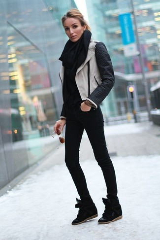 How to wear: black suede wedge sneakers, black skinny jeans, black turtleneck, black and white leather biker jacket