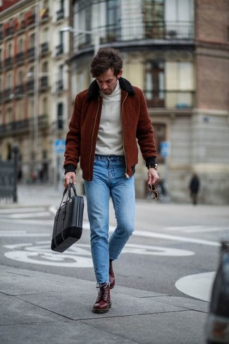 How to wear: burgundy leather casual boots, blue skinny jeans, white turtleneck, burgundy bomber jacket