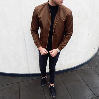 How to wear: black low top sneakers, black skinny jeans, black turtleneck, brown bomber jacket
