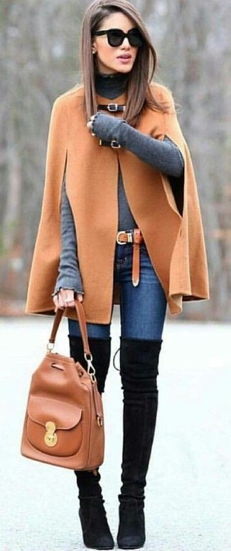 How to wear: black suede over the knee boots, blue skinny jeans, grey turtleneck, camel cape coat