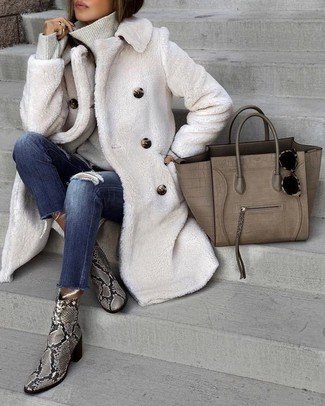 How to wear: grey snake leather ankle boots, navy ripped skinny jeans, grey turtleneck, white textured coat