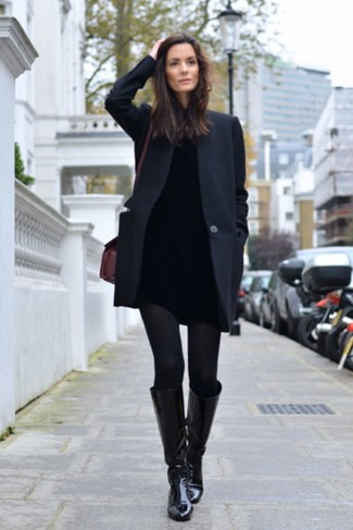 How to wear: black leather knee high boots, black skinny jeans, black turtleneck, black coat