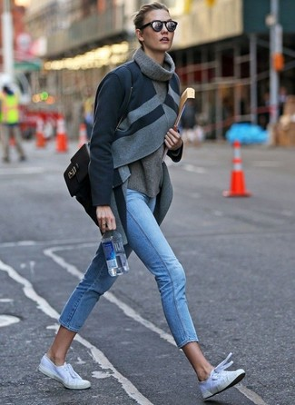 How to Wear Light Blue Skinny Jeans: Putting together a charcoal coat with light blue skinny jeans is an on-point option for a laid-back look. A pair of white canvas low top sneakers effortlesslly ramps up the cool of your outfit.