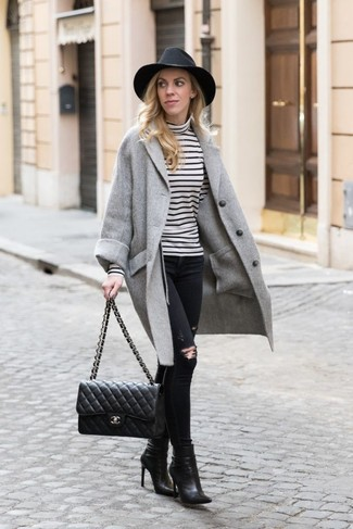 How to wear: black leather ankle boots, black ripped skinny jeans, white and black horizontal striped turtleneck, grey coat