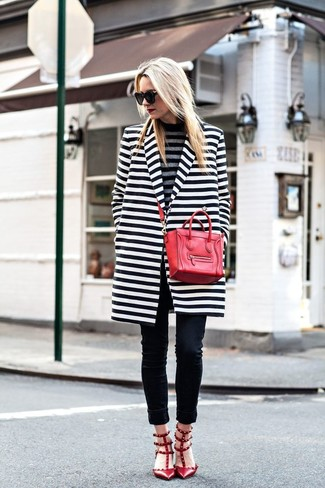 How to wear: red studded leather pumps, black skinny jeans, grey horizontal striped turtleneck, white and black horizontal striped coat