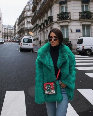 How to wear: multi colored print leather crossbody bag, light blue skinny jeans, black turtleneck, green fur jacket