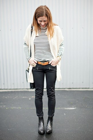 How to wear: black leather ankle boots, black leather skinny jeans, white and black horizontal striped turtleneck, white knit open cardigan