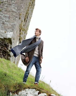 How to wear: navy chevron scarf, blue skinny jeans, white knit turtleneck, dark brown overcoat