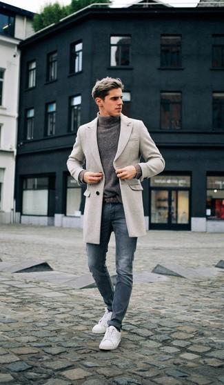 How to wear: white low top sneakers, blue skinny jeans, grey turtleneck, grey overcoat