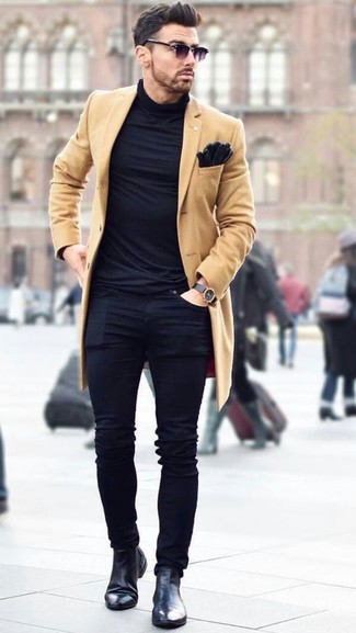How to wear: black leather chelsea boots, black skinny jeans, black turtleneck, camel overcoat