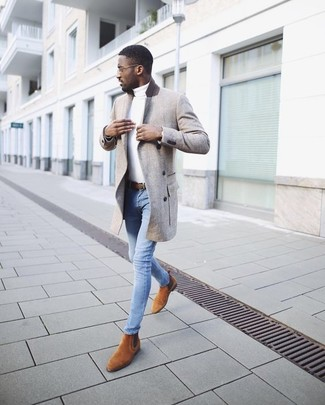 How to wear: tobacco suede chelsea boots, light blue skinny jeans, white turtleneck, grey overcoat