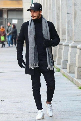 How to wear: white leather low top sneakers, black ripped skinny jeans, black turtleneck, black overcoat