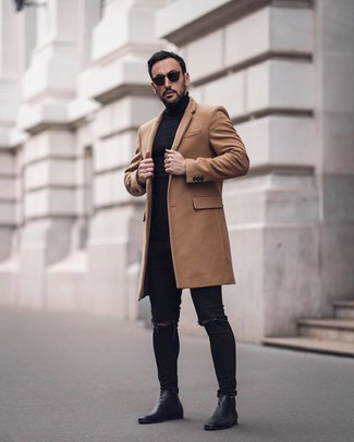How to wear: black leather chelsea boots, black ripped skinny jeans, black turtleneck, camel overcoat