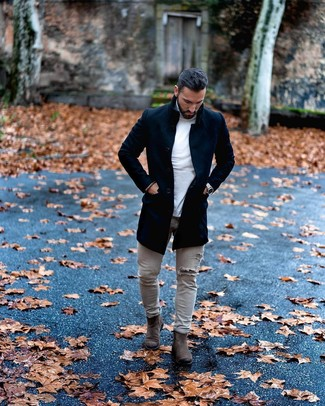 How to wear: charcoal suede chelsea boots, grey ripped skinny jeans, white turtleneck, black overcoat