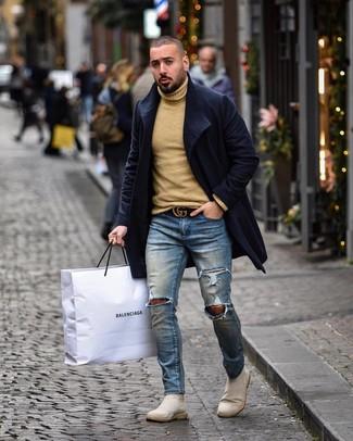 How to wear: beige suede chelsea boots, blue ripped skinny jeans, tan wool turtleneck, navy overcoat
