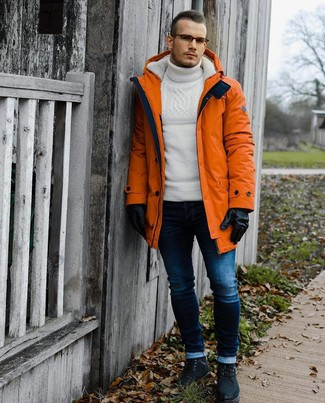 How to wear: black suede casual boots, navy skinny jeans, white knit wool turtleneck, orange parka