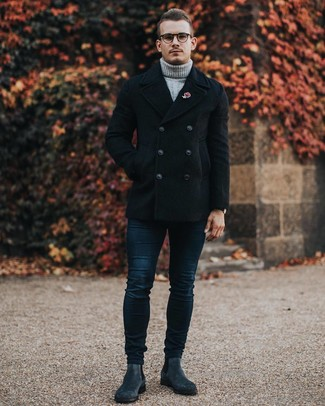 How to wear: charcoal suede chelsea boots, navy skinny jeans, grey knit wool turtleneck, black pea coat