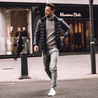 How to wear: white leather low top sneakers, grey skinny jeans, grey knit turtleneck, black puffer jacket