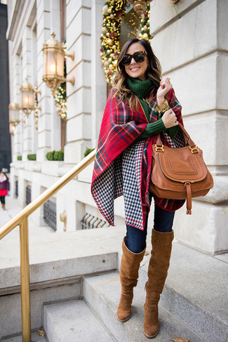 How to wear: brown suede over the knee boots, navy skinny jeans, dark green knit turtleneck, red and navy plaid shawl