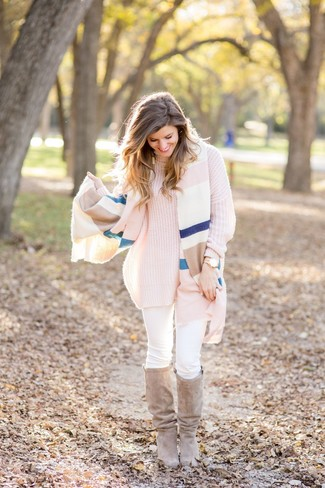 How to wear: beige suede knee high boots, white skinny jeans, pink knit turtleneck, multi colored horizontal striped shawl