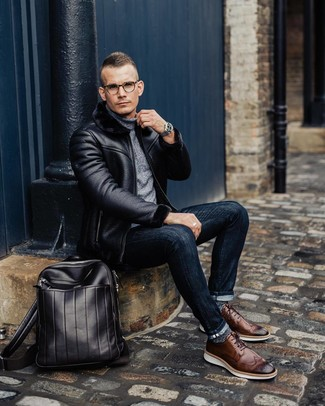 How to wear: brown leather brogues, navy skinny jeans, grey turtleneck, black shearling jacket