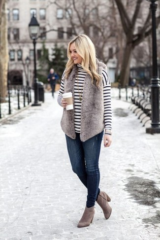 Women's Looks & Outfits: What To Wear In 2020: A grey fur vest and navy skinny jeans are the kind of a no-brainer casual look that you so awfully need when you have no time. Infuse this getup with an added dose of style by sporting grey suede ankle boots.