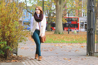 Which Boots To Wear With a Brown Leather Crossbody Bag: Extremely stylish and practical, this combo of a beige knit vest and a brown leather crossbody bag brings wonderful styling possibilities. Look at how nice this getup goes with a pair of boots.