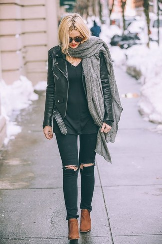 How to wear: tobacco leather ankle boots, black ripped skinny jeans, black v-neck sweater, black leather biker jacket