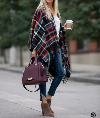 How to wear: brown suede ankle boots, navy skinny jeans, white v-neck sweater, multi colored plaid cape coat