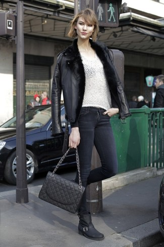 How to wear: black leather mid-calf boots, black skinny jeans, white v-neck sweater, black shearling jacket