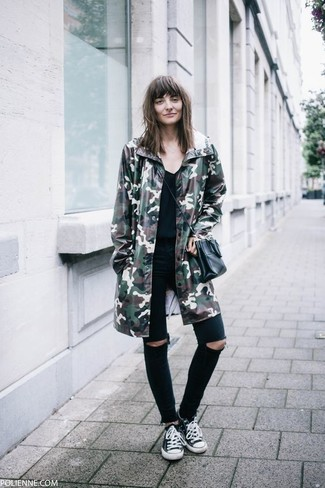How to wear: black and white canvas low top sneakers, black ripped skinny jeans, black v-neck t-shirt, dark green camouflage parka