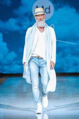How to wear: white high top sneakers, light blue ripped skinny jeans, white v-neck t-shirt, white windbreaker