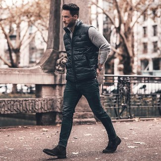 How to Wear Navy Skinny Jeans For Men: If you use a more casual approach to dressing up, why not go for a black gilet and navy skinny jeans? Not sure how to complement your ensemble? Wear a pair of black suede dress boots to kick it up a notch.