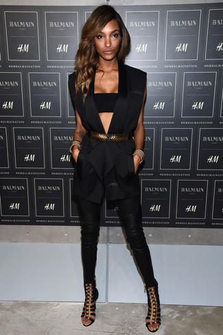 How to wear: black suede heeled sandals, black leather skinny pants, black bustier top, black sleeveless blazer
