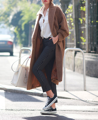 How to wear: black and white canvas low top sneakers, black and white vertical striped skinny pants, white button down blouse, brown coat