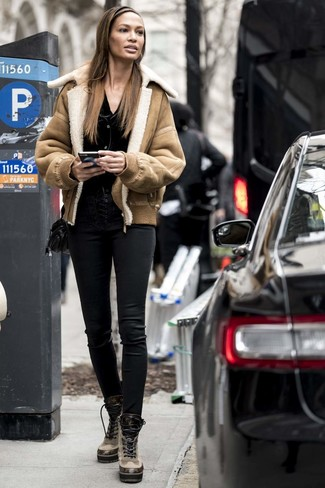 How to wear: tan leather lace-up flat boots, black leather skinny pants, black cardigan, tan shearling jacket