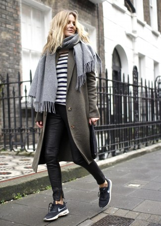 How to wear: black and white athletic shoes, black leather skinny pants, white and black horizontal striped crew-neck sweater, olive coat