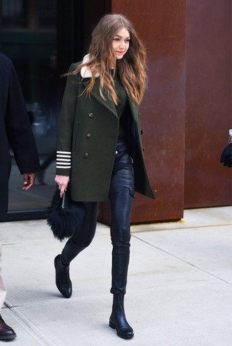 How to wear: black leather chelsea boots, black leather skinny pants, dark green crew-neck sweater, dark green coat