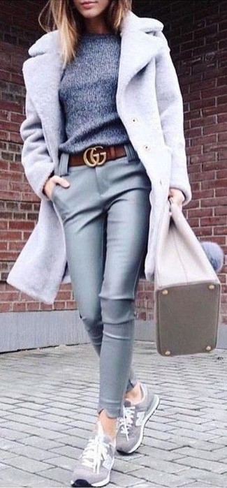 How to wear: grey suede low top sneakers, grey leather skinny pants, grey crew-neck sweater, grey coat