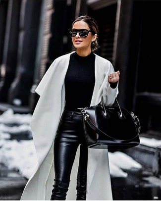 How to wear: black leather tote bag, black leather skinny pants, black crew-neck sweater, white duster coat