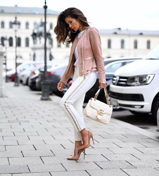 How to wear: tan leather pumps, white skinny pants, white crew-neck t-shirt, pink leather biker jacket