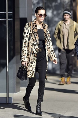 How to wear: black leather lace-up ankle boots, black skinny pants, black crew-neck t-shirt, tan leopard fur coat