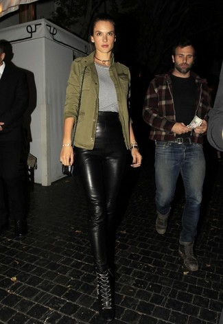 How to wear: black leather lace-up ankle boots, black leather skinny pants, white and black horizontal striped crew-neck t-shirt, olive military jacket