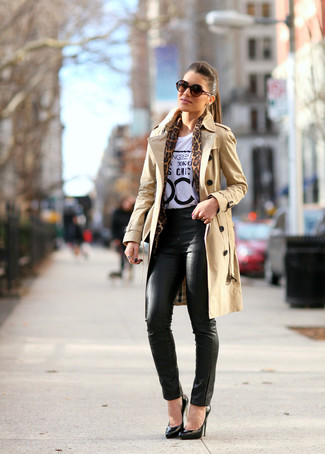 How to wear: black leather pumps, black leather skinny pants, white and black print crew-neck t-shirt, tan trenchcoat