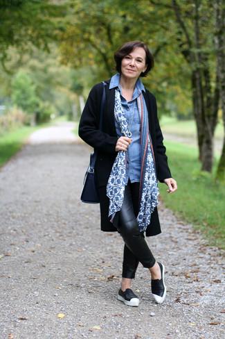 How to wear: black leather slip-on sneakers, black leather skinny pants, blue denim shirt, black coat