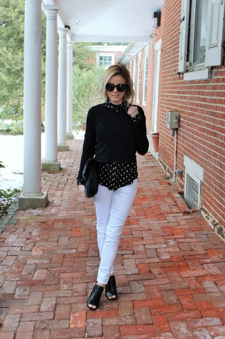 How to wear: black cutout leather ankle boots, white skinny pants, black and white print dress shirt, black crew-neck sweater
