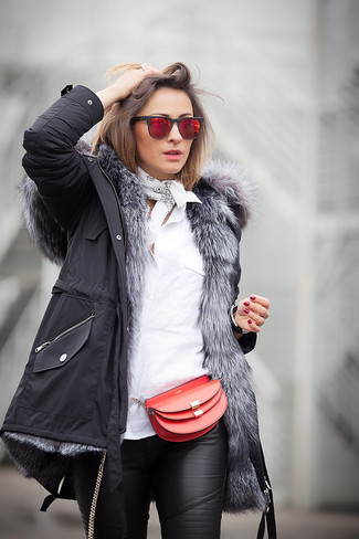How to wear: red leather crossbody bag, black leather skinny pants, white dress shirt, black parka