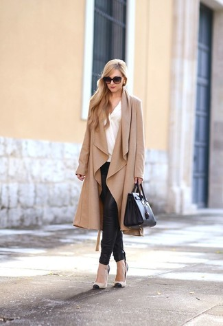 How to wear: black and tan leather pumps, black leather skinny pants, white long sleeve blouse, tan duster coat