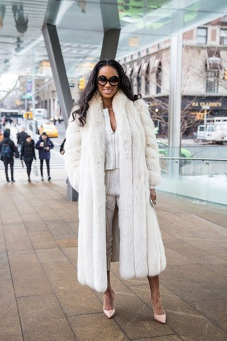 How to wear: beige leather pumps, white print skinny pants, white print long sleeve blouse, white fur coat