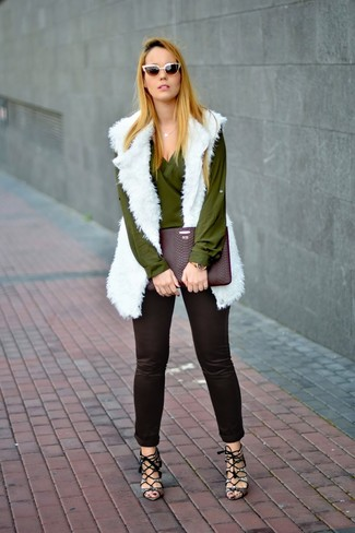 How to wear: grey snake leather heeled sandals, black skinny pants, olive long sleeve blouse, white fur vest